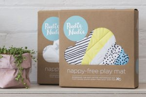 2 boxes containing Rudie Nudie baby play mats
