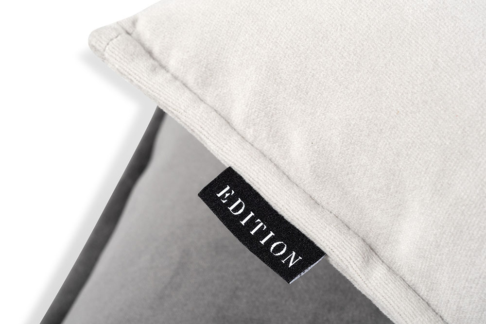 corner of a cushion, with brand label EDITION