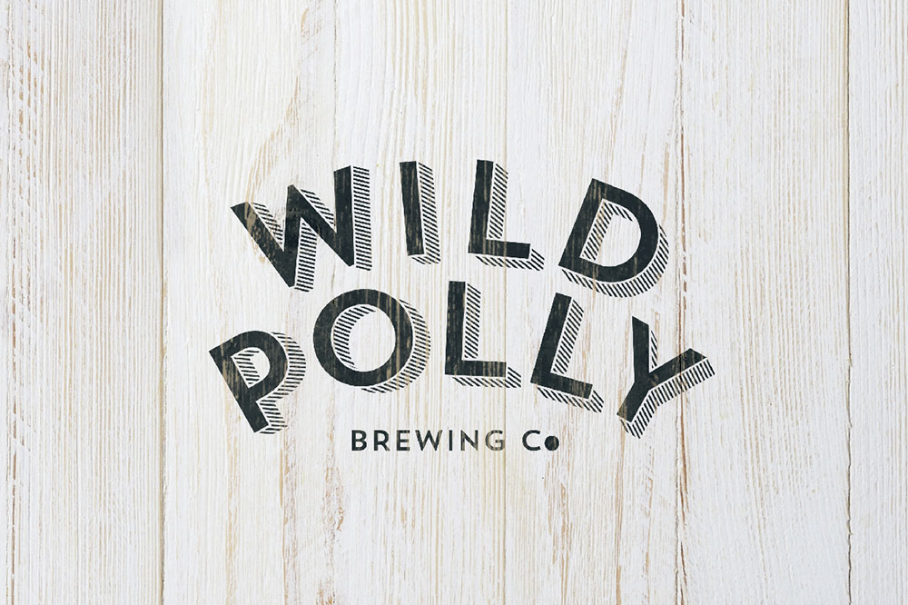 Wild Polly Logo mockup on wooden background