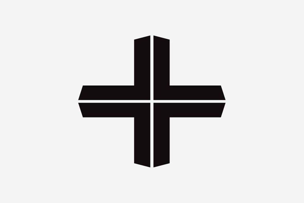 Black cross symbol for Nathan and Jac brand